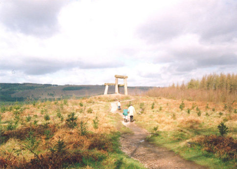 Landscape picture, with sculpture of a wooden chair on the horizon