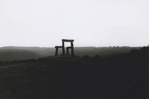 Black and white photo of wooden chair sculpture silhouette